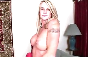 Busty fair-haired milf toys her twat