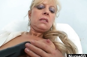 Aged blonde milf stuffing pussy with huge dildo