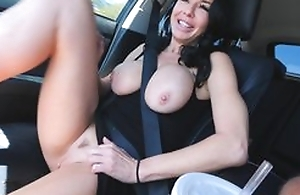 Raven haired adult in high heels masturbates in hammer away car