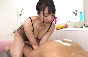 Sexy Japanese girl with big natural tits licks BF's asshole