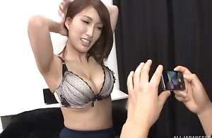 Busty Oriental dame teases boyfriend with the brush racy melons