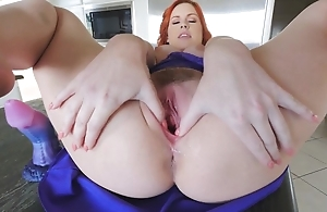 Stunning redhead generalized with chunky naturals masturbates in the kitchen
