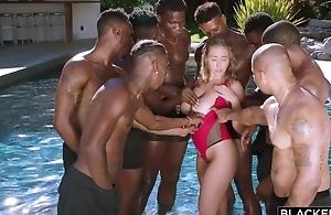 Insatiable nympho near chubby on the level tits enjoys interracial gangbang