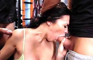 Cock-loving brunette respecting natural boobs gets drilled hard nearly the gym