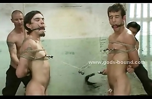 Naked cheerful prisoner tied in venal bondage sex with amulet master