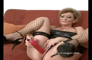 Cougar sucks out of reach of cock while using dildo out of reach of her pussy