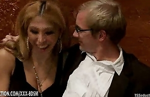 Horny gentleman in a suit enjoys viva voce sex from ladyboy