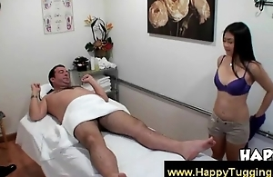 Oriental masseuse wanking customer