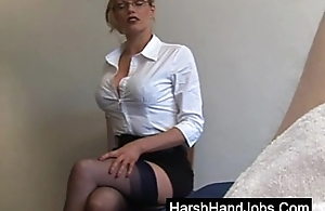 Secretary type gives a bitter handjob